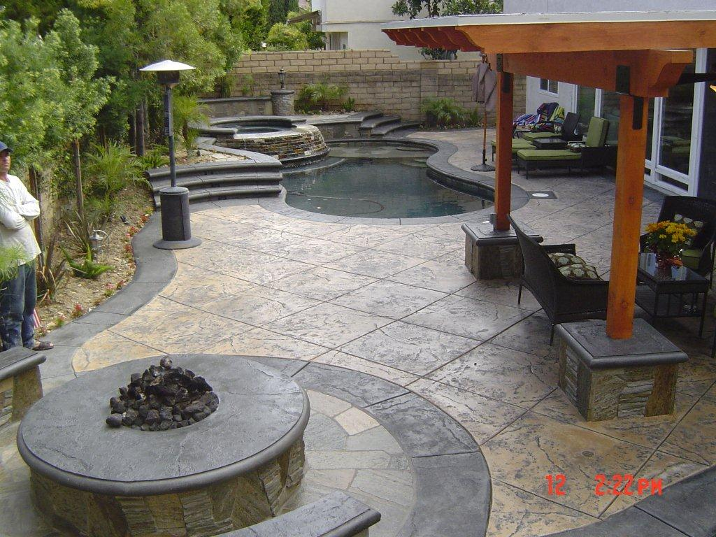 Stone patio fire pit backyard remodel opr pools for Pool design ventura